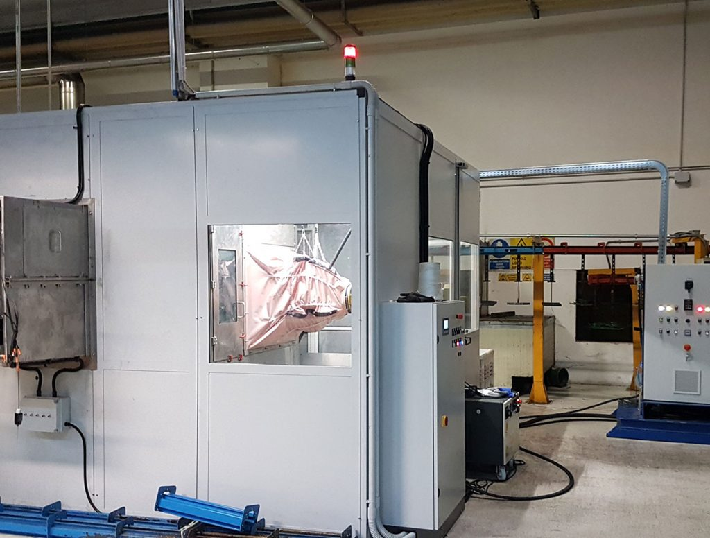 Automated in-line cleaning system with photo insulation cabin